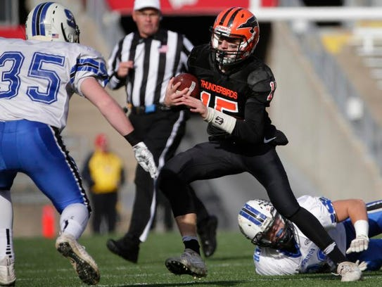 Iola-Scandinavia quarterback Connor Kurki makes a move on St. Mary's Springs linebacker Marcus Orlando in the first quarter of the WIAA Division 6 state football championship at Camp Randall Stadium in Madison. Kurki, a sophomore, will be back for the Thunderbirds.