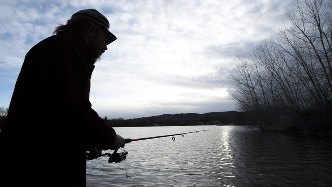 Austin Humphreys/The Coloradoan Aaron Bruno kills some time by fishing at Sheldon Lake in City Park Tuesday. Fort Collins planners are looking at options to improve the 104-year-old park, including the lake. Aaron Bruno kills some time by fishing at Sheldon Lake in City Park Tuesday, March 15, 2016. Fort Collins planners are looking at options to improve the 109-year-old park including the lake.