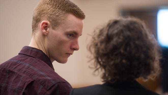Tanner Flores looks to one of his defenders, Janet Laughon, as they stand in the court room at the Larimer County Justice Center on Tuesday, October 3, 2017.