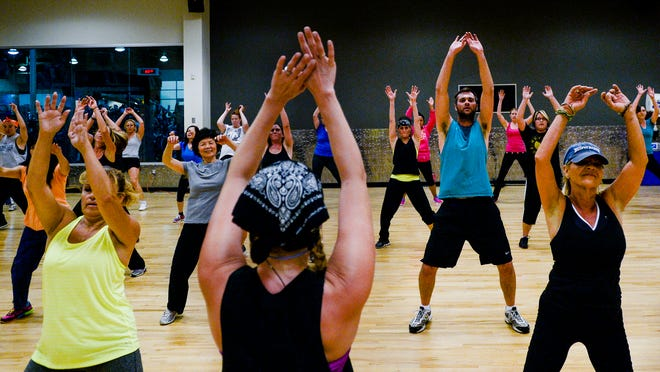 People gather at 24-hour Fitness for a high-energy dance workout in this Coloradoan file photo. 24-Hour Fitness plans to open a second Fort Collins location in April at 460A S. College Ave.