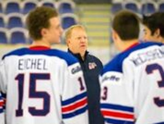 In this undated photo, Jim 'J.J.' Johannson (center) chats with USA Hockey players.