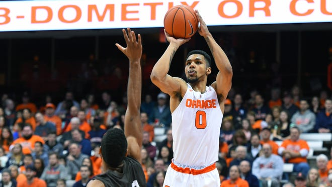 Michael Gbinije (0) shoots the ball as Lehigh forward Justin Goldsborough (40) defends during the first half at the Carrier Dome on Nov. 13.
