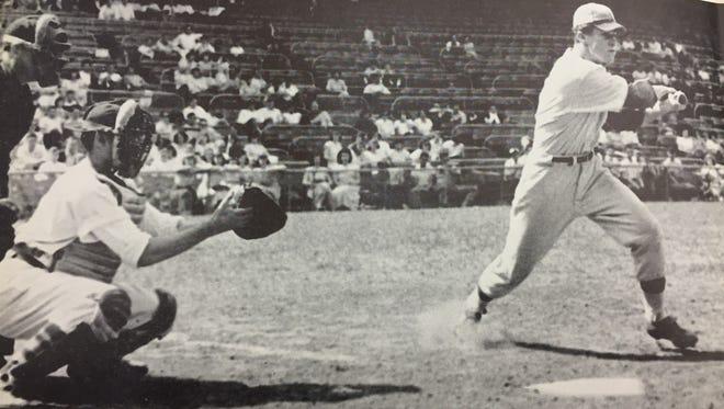 Hughes' Al Janszen hits at Crosley Field in 1949.