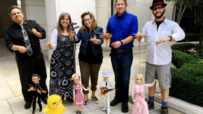 "The Wishing Chair Productions puppet team loves the ""String City"" performances. From left, Brian Hull with Johnny Cash, Mary Tanner Bailey, with a Dixie Chick, Evelyn O'Neal Brush with Minnie Pearl, Josh Martin with Hank Williams and Library Pete with Dolly Parton."