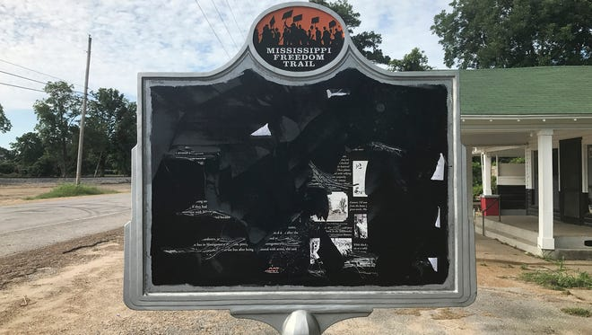 In this June 2017 photo, released by Allan Hammons, a civil rights historical marker in Money, Miss., is seen. The marker remembers black teenager Emmett Till, who was kidnapped before being lynched in 1955. Allan Hammons, whose public relations firm made the marker, said Monday, June 26, 2017, that someone scratched the marker with a blunt tool in May.