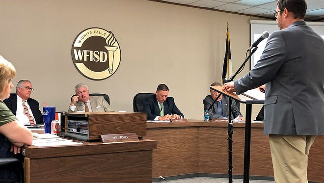 Wichita Falls ISD Associate Superintendent Peter Griffiths (right) presents WFISD's district improvement plan to the Board of Trustees Monday evening.