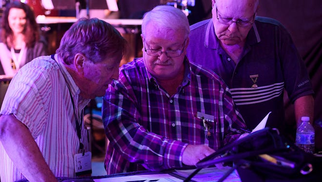 Miss Tennessee Scholarship Pageant President and Co-producer Jimmy Exum talks with Robert Boren and Dwayne Parker during rehearsals for the pageant, Tuesday evening, June 19. Boren and Parker assist the pageant with props as well as microphones.