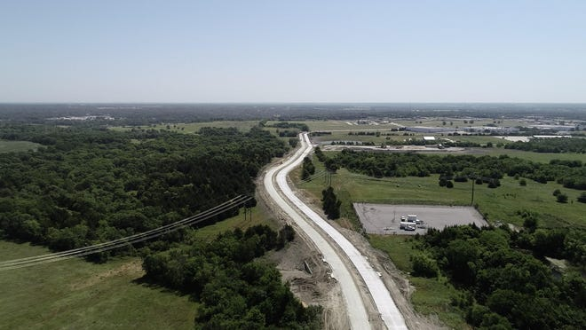 An aerial short shows the route of the extended West Travis, which will connect the Sherman High School site to the U.S. Hwy. 75 service road. The Sherman City Council recently approved a $445,000 change order to the project to add an expansion to Steeplechase Drive to the scope of the project.