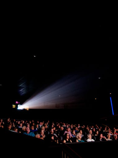"Hundreds of audience members watch the first Phoenix-area showing of ""The Wall"" on July 16, 2018, during a showing of the Arizona Republic's Pulitzer Prize-winning project ""The Wall"" at Harkins Theater in Scottsdale, Arizona."
