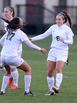 Novi's Devon Powers (right) and Amanda Minissale (left) celebrate after scoring the first goal against South Lyon East.