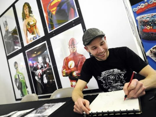 Comic book illustrator Dirk Shearer was on hand outside of Comix Connection's York location in West Manchester Mall in 2012. On Friday, he'll speak to teens and tweens at Guthrie Memorial Library. (FILE PHOTO)