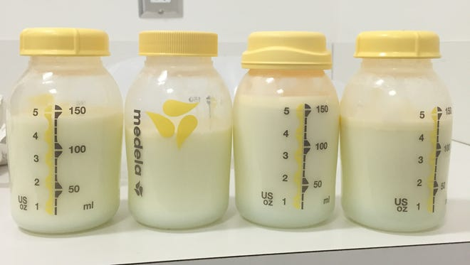 These four bottles of pumped breast milk represent one day of pumping at the office.