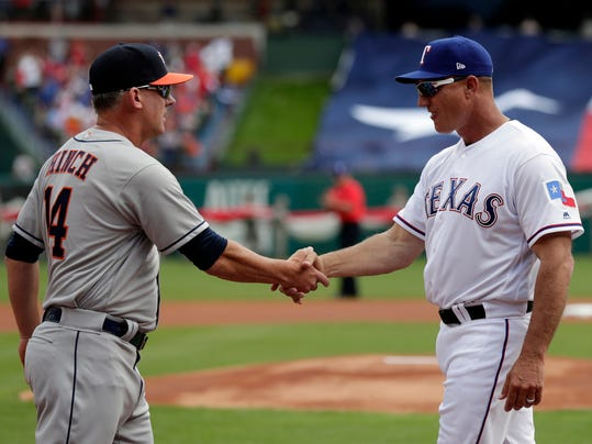 Houston Astros manager AJ Hinch, left, and Texas Rangers manager Jeff Banister, right, greet each other at home plate during team introductions before an opening day baseball game in Arlington, Texas, Thursday, March 29, 2018. (AP Photo/Tony Gutierrez)