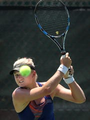 Chanel Simmonds returns a shot by Arina Rodionova at the Hunt Communities $25,000 Women's Pro Tennis Classic at Tennis West Sports & Racquet Club. Simmonds won.