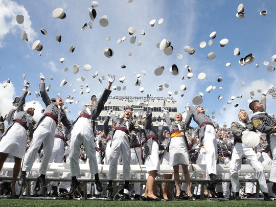 West Point cadets throw their covers at the close of the graduation ceremony for the Class of 2017 at United States Military Academy at West Point on Saturday, May 27, 2017.