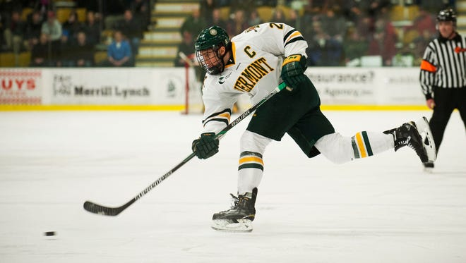 UVM defenseman Mike Paliotta (2) takes a shot during the Hockey East quarterfinal men's hockey game between the Maine Black Bears and the Vermont Catamounts on March 6. Paliotta signed a two-year contract with the Chicago Blackhawks on Thursday.