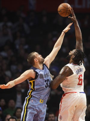 Los Angeles Clippers' DeAndre Jordan, right, shoots over Memphis Grizzlies' Marc Gasol during the first half of an NBA basketball game Tuesday, Jan. 2, 2018, in Los Angeles. (AP Photo/Jae C. Hong)