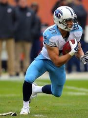 Titans wide receiver Marc Mariani (87) returns a kick