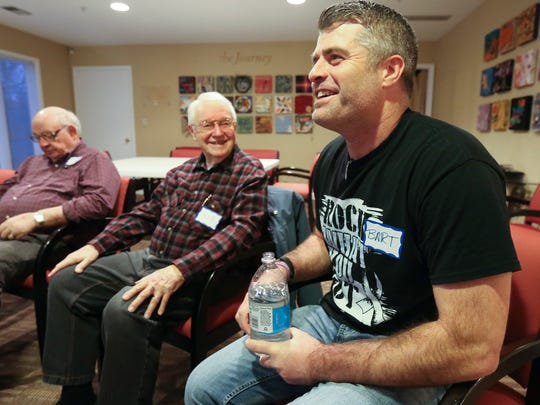 Bart Conley, right, jokes around with other members of a support group with other widowers at Hosparus.