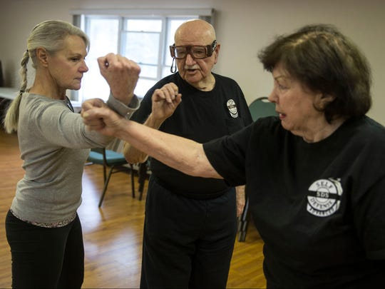 Doria Dalo of Toms River works on defense maneuvers during the class. Walter Miller is the instructor of a self-defense course for Berkeley Township Recreation Department that helps senior citizens learn to defend themselves in the event of an emergency. Berkeley Township, NJTuesday, January 31, 2017.@dhoodhood