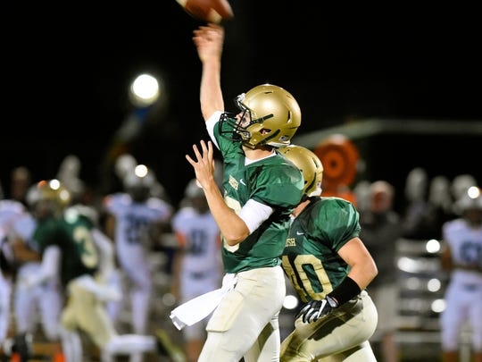 York Catholic quarterback Wes Burns throws a pass during
