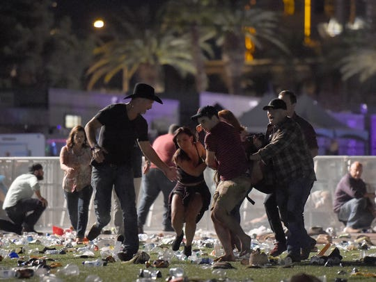 Scenes from the shooting Sunday night in Las Vegas.
