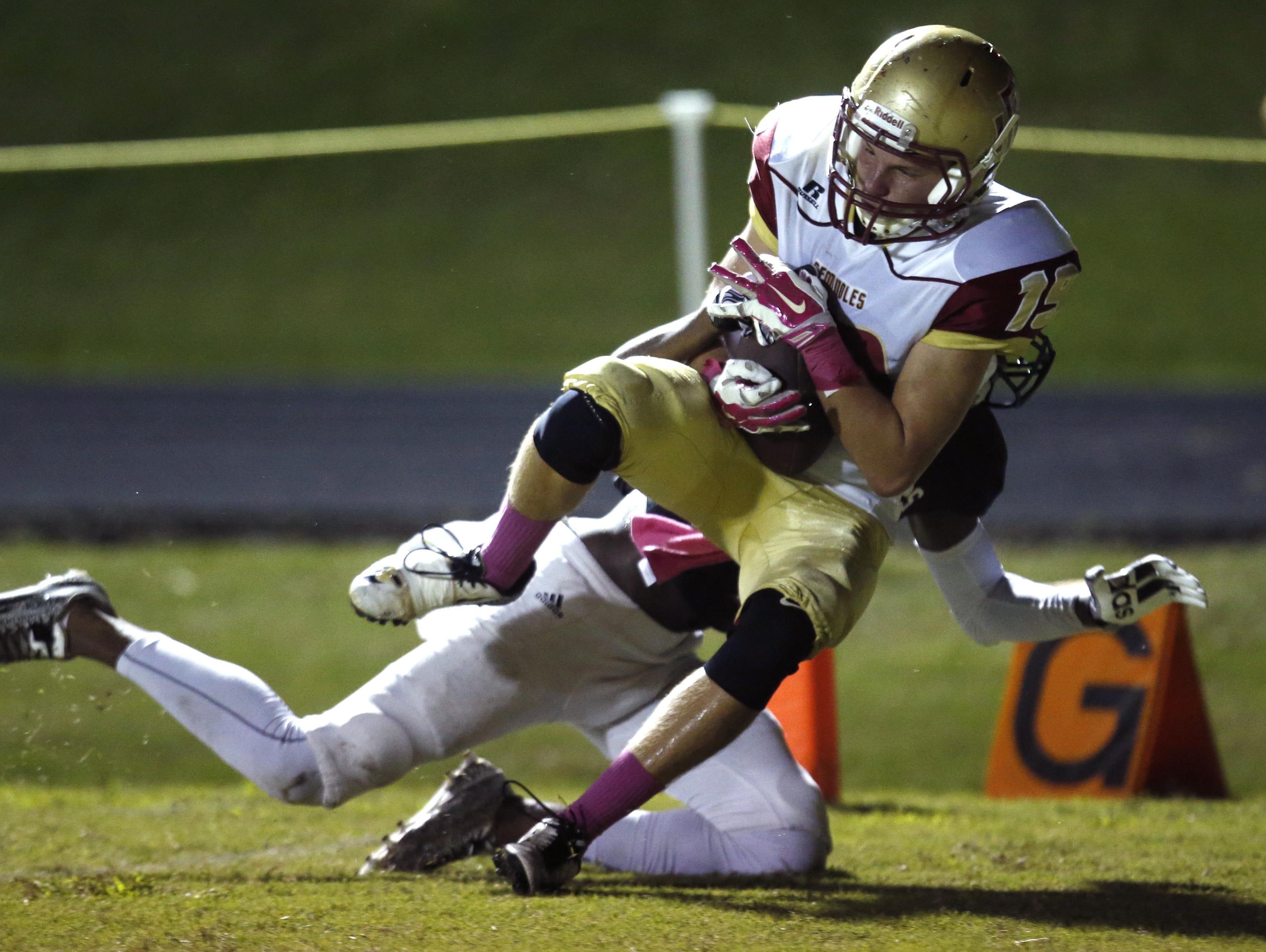 Florida High's Christian McGowan catches a touchdown pass against NFC on Friday.