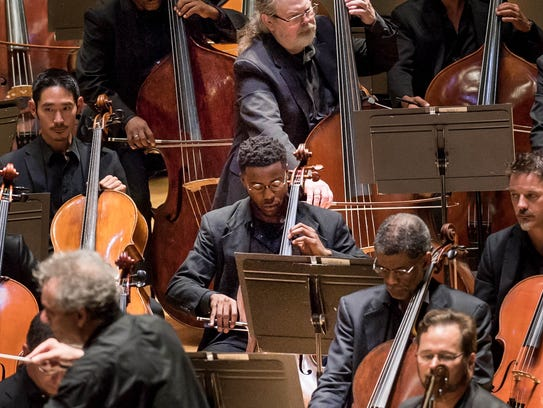 Blake-Anthony Johnson, center, a cellist who was awarded