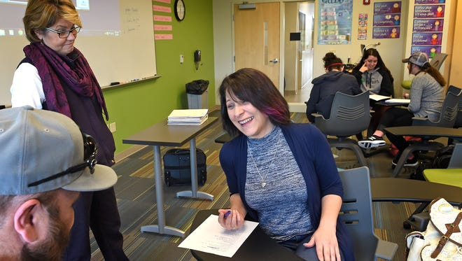 As professor Susan Rockwood, left, looks on, Gaynell Payne, 43, laughs as she learns French with much younger students at Volunteer State Community College. Payne is on track to finish an associate's degree in English this year.