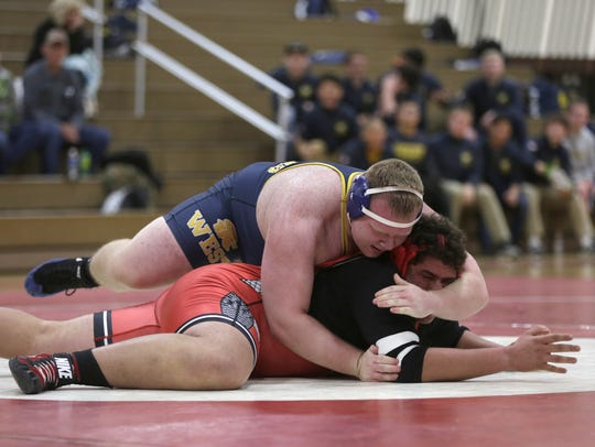 Wausau West's Tim Mineau (top) owns a 23-6 record.