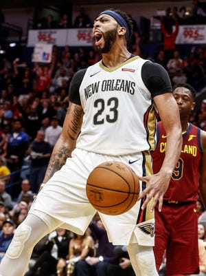 New Orleans Pelicans forward Anthony Davis (23) celebrates after a dunk against the Cleveland Cavaliers.