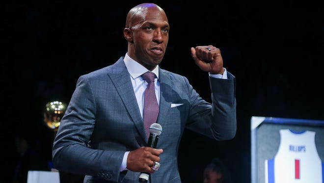 Pistons legend Chauncey Billups talks to fans before his jersey is retired during halftime of the Pistons-Nuggets game Wednesday at the Palace.