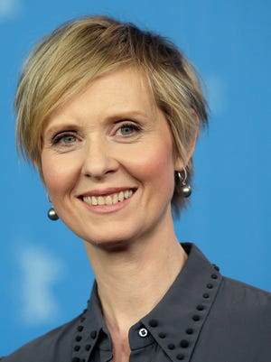 Actress Cynthia Nixon said she is still considering a run for New York governor in a Democratic primary against Gov. Andrew Cuomo.
