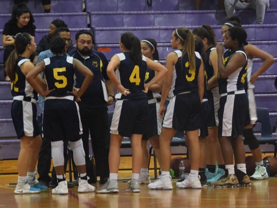 The Guam High Panthers call a timeout in their IIAAG basketball game against the George Washington High School Geckos on Tuesday night.
