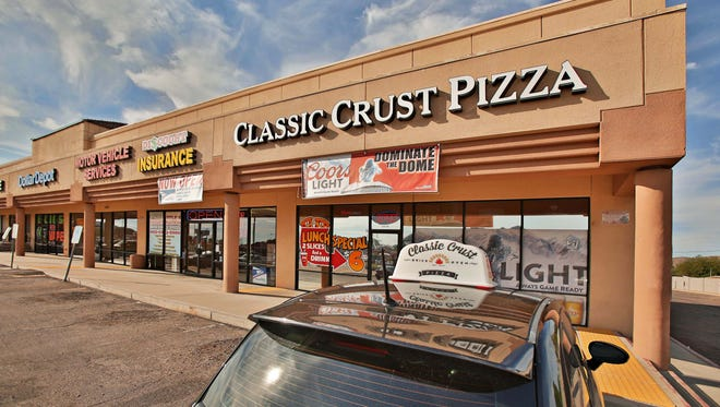 The exterior and logo of Classic Crust Pizza in Phoenix.