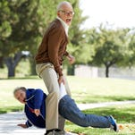 """Johnny Knoxville, standing, and Jackson Nicoll in a scene from""""Jackass Presents Bad Grandpa."""""""