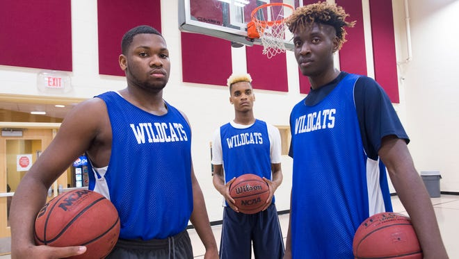 Washington High School Basketball  player, David Reynolds, Jr., left, Michael Randolph, Jr. ,center, and Tyrelle McGee are looking to lead the Wildcats to victory of cross-town rivals PHS.
