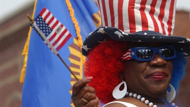 A festive partygoer paints herself American in 2008 in this file photo.