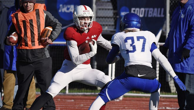 Matt Miller handles the ball during the St. John's University Division III first-round playoff win over Dubuque last season. The Annandale graduate moved to tight end as a sophomore last fall, but is back at wide receiver this spring.