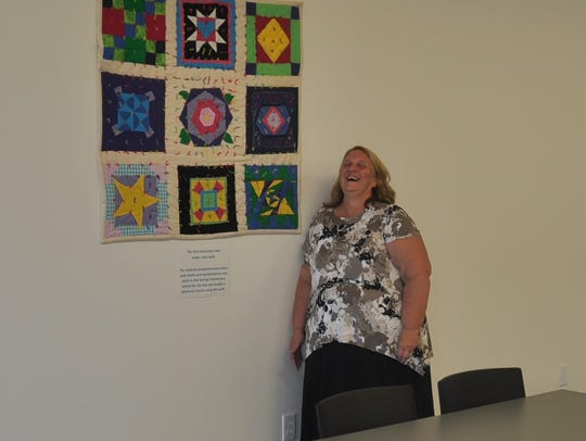 Linda Ammons smiles inside her new classroom in front