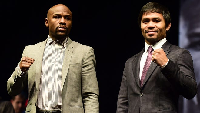 Boxers Manny Pacquiao (R) from the Philippines and Floyd Mayweather from the US pose during a press conference on March 11, 2015 in Los Angeles, California, to launch the countdown to their May 2, 2015 super-fight in Las Vegas.
