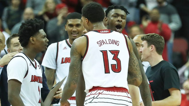 Louisville's Lance Thomas yells encouragement to Ray Spalding in the waning moments of the Cards' 71-62 win Saturday, Dec. 9, at the KFC Yum! Center in downtown Louisville. Spalding had 10 points and 14 rebounds.