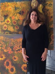 "Artist Loren Harris-Heller is working on a new series of paintings titled, ""Sunflowers."" She is among nine artists opening their studios and homes for Saturday's Artists Studio Tour in Rancho Mirage."