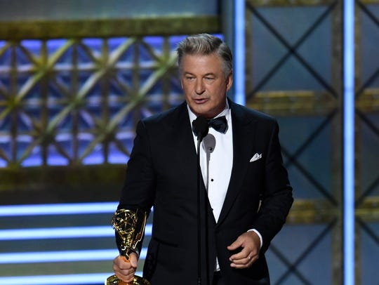Alec Baldwin accepts the award for supporting actor