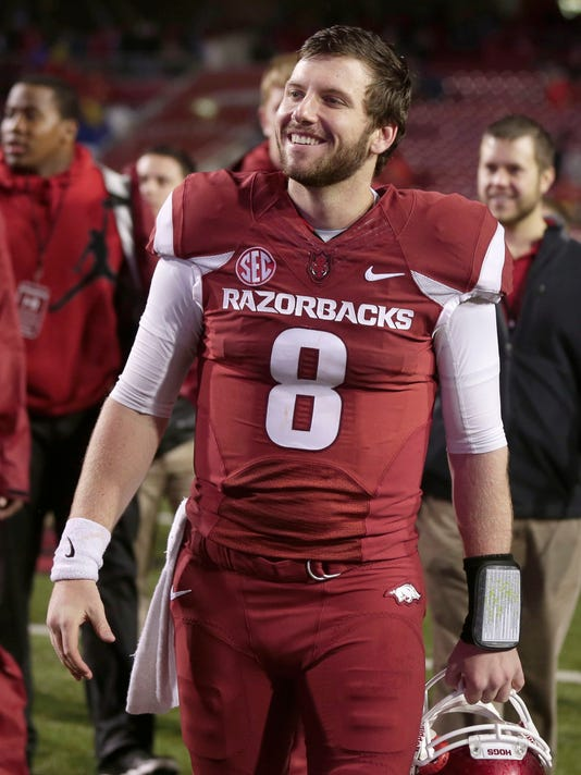 Arkansas quarterback Austin Allen walks from the field after an NCAA college football game Saturday, Nov. 22, 2014, in Fayetteville, Ark. Arkansas defeated Mississippi 30-0. (AP Photo/Sarah Bentham)