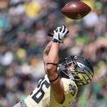 Oregon's Casey Eugenio catches a touchdown pass in the fourth quarter during the Ducks spring game on Saturday, May 2, 2015, at Autzen Stadium in Eugene.