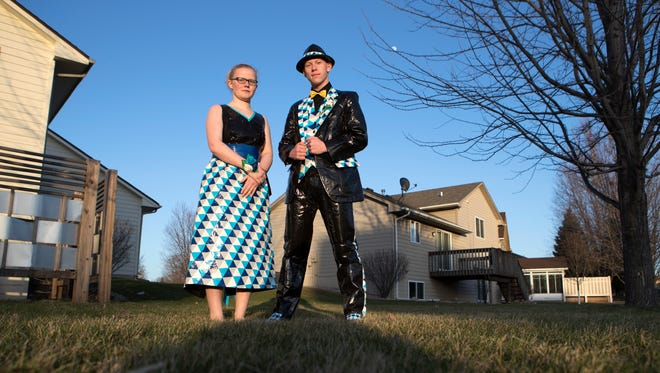 Troian Loken, 15, and Brent Bartels, 18, pose in their duct tape prom outfits in Sioux Falls, S.D. on Thursday, April 26, 2018.