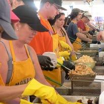 Lisa Almandinger, applications manager at Klondike Cheese, Monroe offers feta samples.