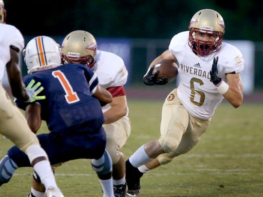Riverdale's Austin Bryant (6) runs the ball during the game against Blackman at Blackman, on Friday Sept. 4, 2015.
