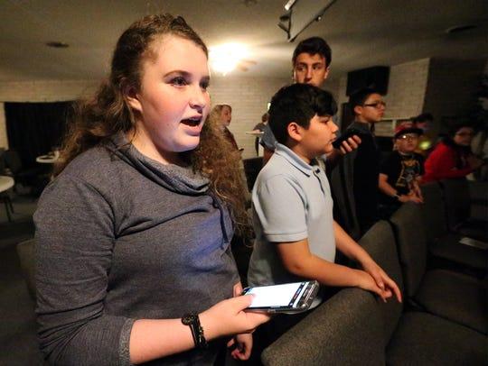 Graciela Blandon, 14, rehearses a song during a rehearsal